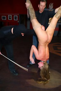 Naked caned while she is suspended upside-down