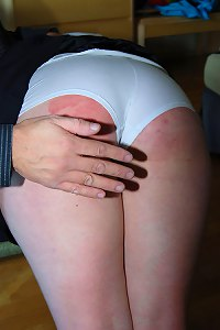 2 beautiful young schoolgirls severely spanked OTK on their bared asses