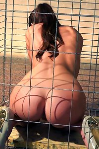 Glamorous beauty seems to be happy in her pet cage: naked, wearing sexy high heels, gagged, tied and pleasured with sex toys  Submissed