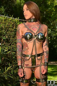 Tattooed Sub beauty gets leashed and locked