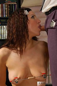 Curly with her nipples clamped gives blowjob