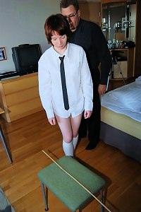 Bare arsed schoolgirl brutally caned over the headmaster