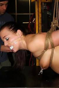 Closeup pictures of hogtied woman&apos  Submissed