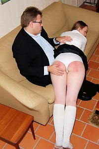 Cute long-haired schoolgirl gets her big round ass spanked