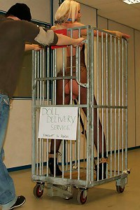 Bondage doll is put in a cage and ready for be delivered to a new owner after the auction  Submissed