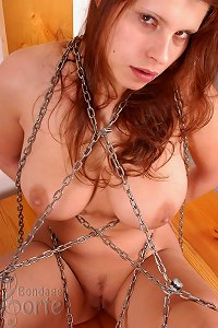 Busty babe cuffed and chained