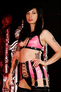 Gorgeous brunette in sexy pink latex