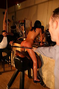 Perfect babe whipped while sitting on horse saddle