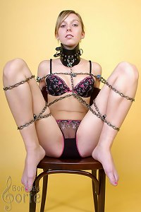 Girl chained on a chair and dildoed