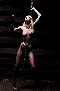 Tiny girl in chains