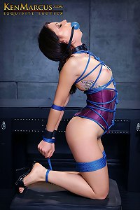 Flexible girl in pink corset tied up and gagged