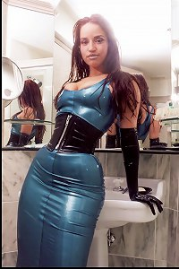 Hot redhead posing in latex