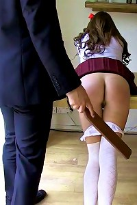 Beating her bare buttocks with a heavy wooden paddle