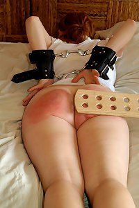 Hot Redhead is bound, paddled and humiliated