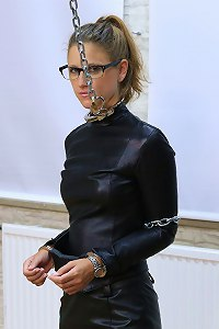 Leather lady Sophia cuffed and gagged