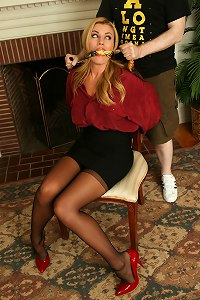 Ball-gagged babe in sexy stockings chair tied